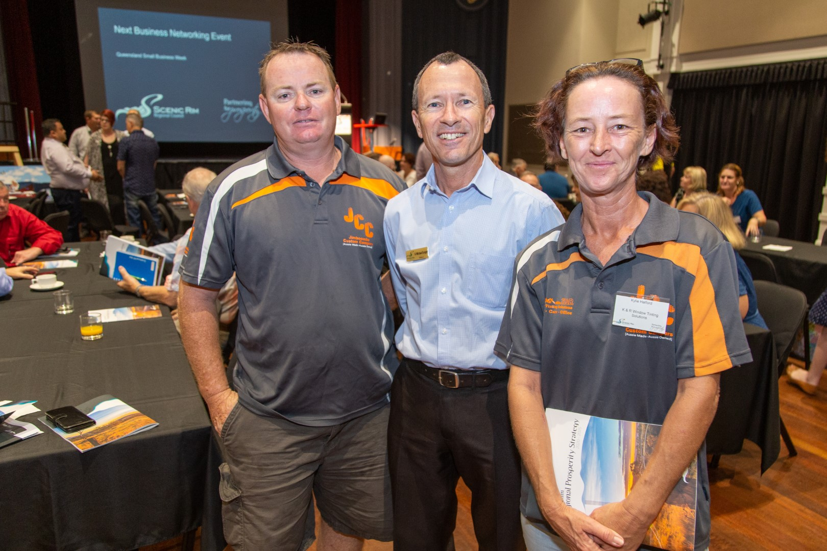 Robert Moore, Jimboomba Custom Campers, Cr Michael Enright and Kylie Halford, K & R Window Tinting Solutions at the February business breakfast.